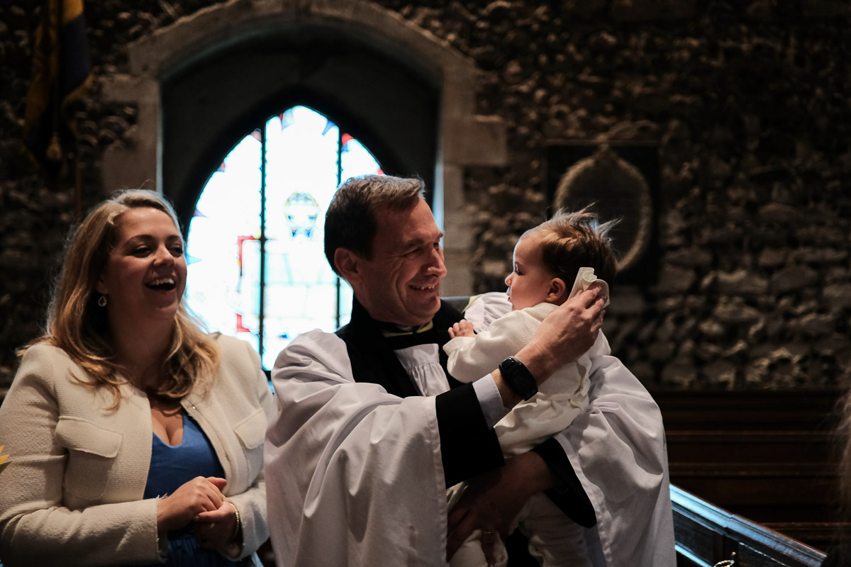 Documentary family photography London. Photograph by Ben Heasman of a beautiful Christening.