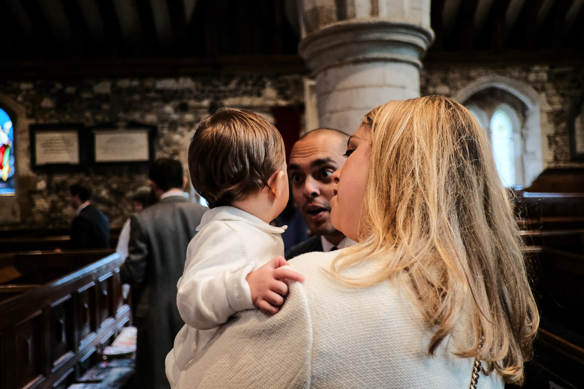 Documentary family photography London. Photograph by Ben Heasman showing friends meeting before a christening.