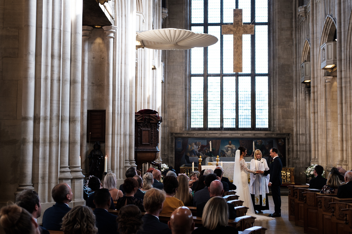 Church scene with bride and groom together at ceremony.