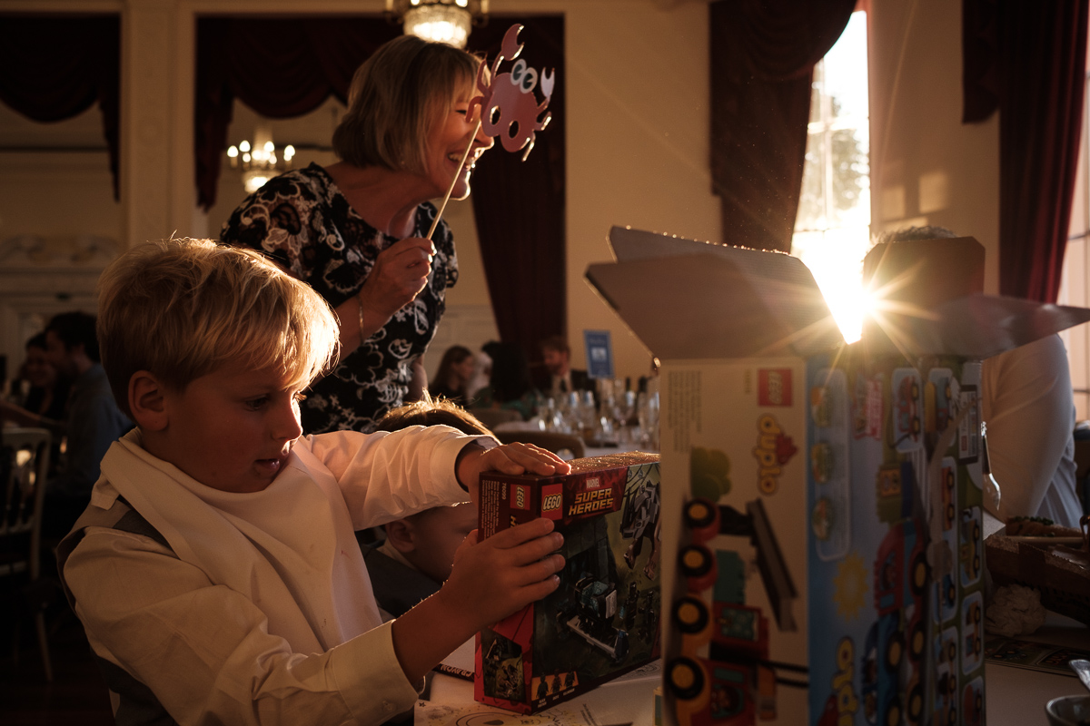 Children opening presents at wedding reception.