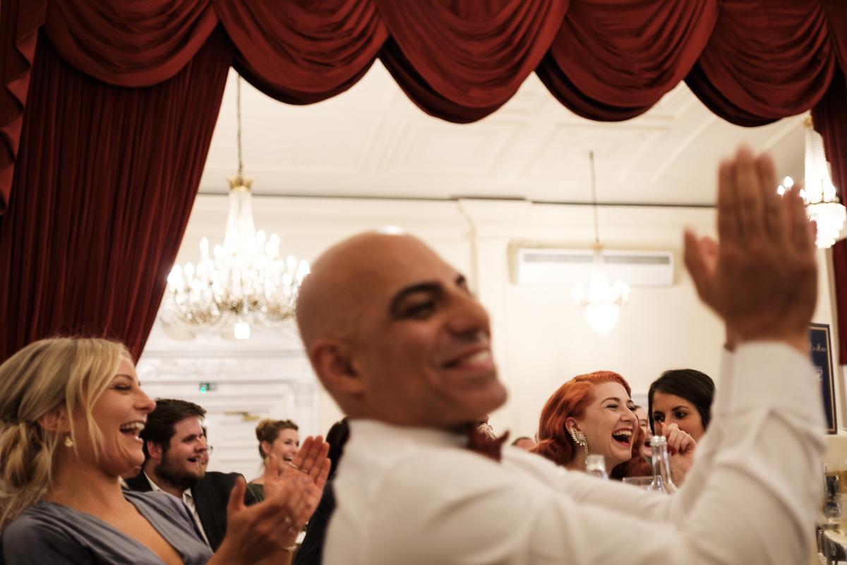Guests enjoy a speech at the wedding reception.