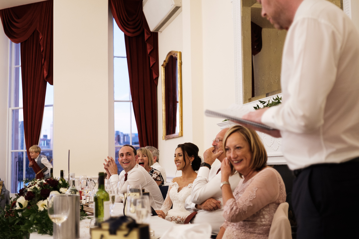 Laughter during wedding speeches.