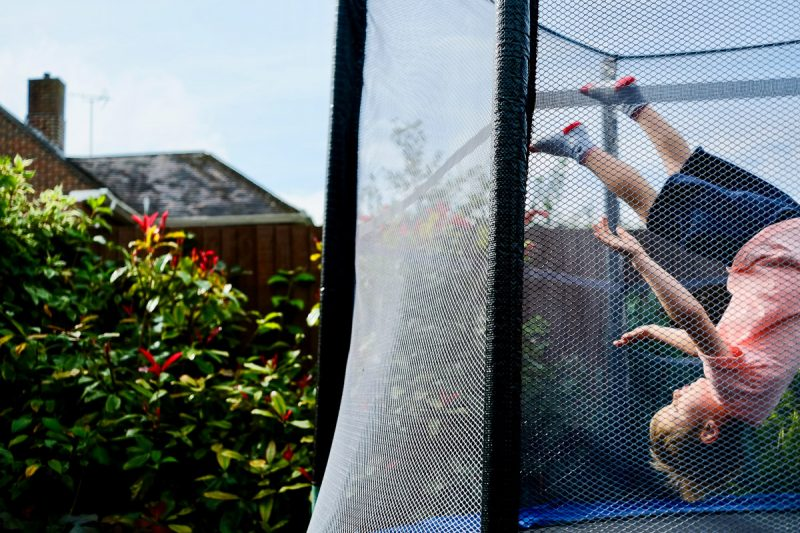 London family photography with Ellis and a trampoline