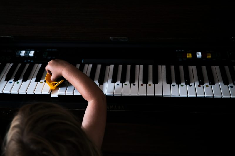 London family photography with Jonah, a piano and a toy