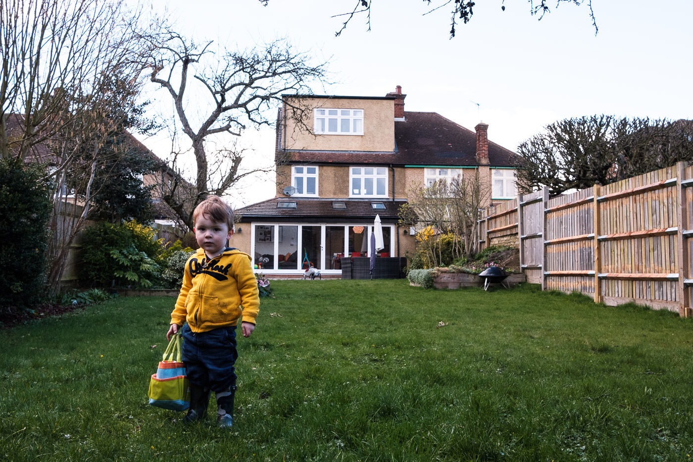 Environmental portrait of a boy in the garden