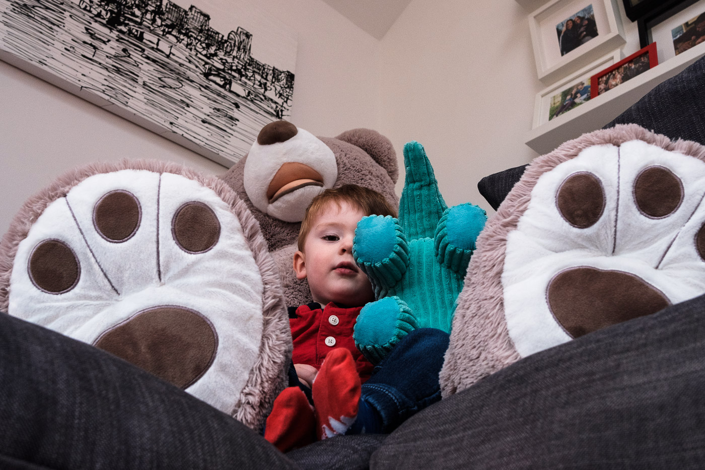 Portrait of boy in front of large teddy